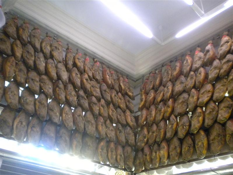 More ham hanging in the store (each one is a pig leg)