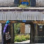 A woman pass by a door