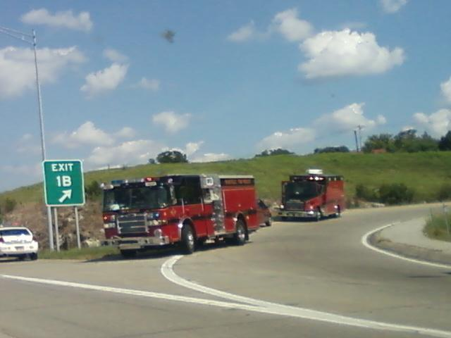 firetrucks and an emergency vehicle behind it