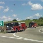 firetrucks and an emergency vehicle behind it