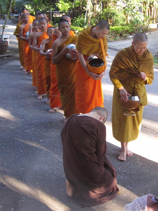 Every morning at 8am, the monks lined up to receive alms. The woman in the front was my teacher for the first week.