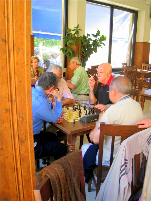 Older gentleman playing chess together