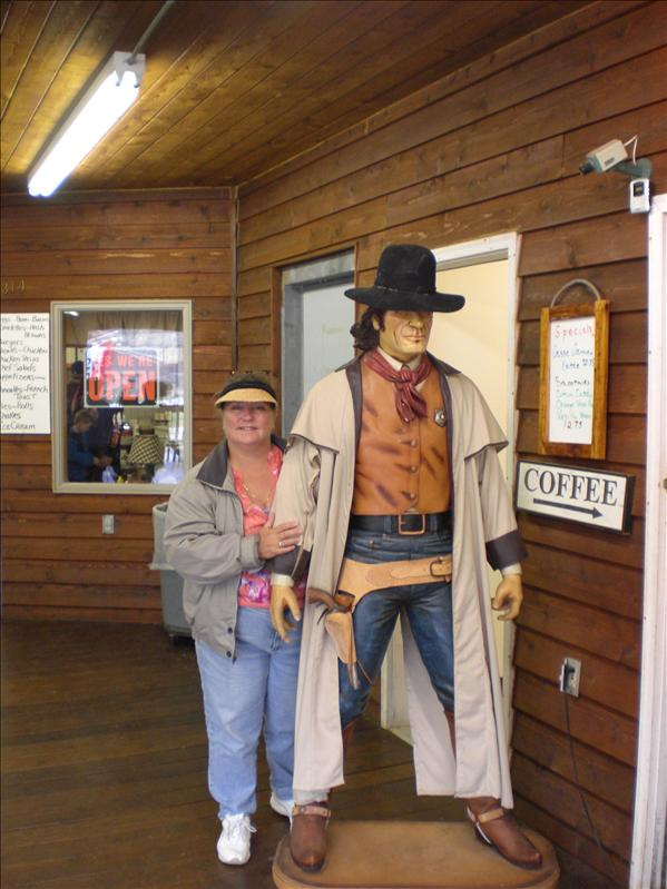 Pat getting giggly with a cowboy.
