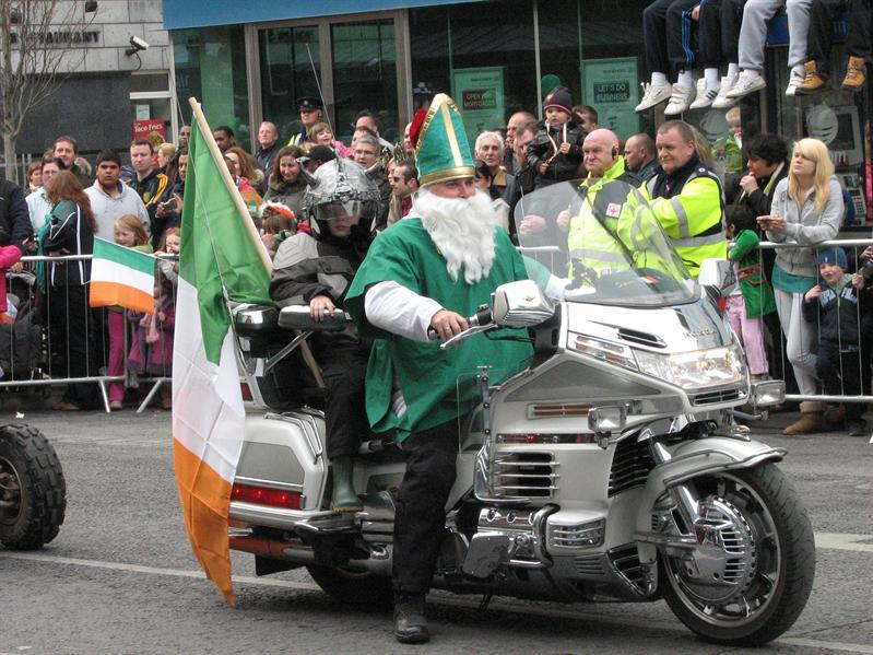Hey look! It's Saint Patrick! On a bike...with a scary looking kid