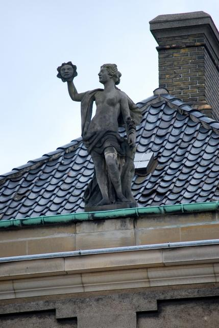 Figure atop the palace