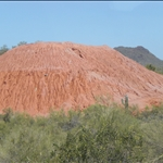Big piles of very out of place red dirt