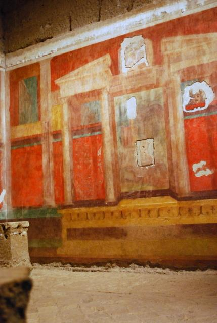 Brightly coloured frescoes like this lined each wall