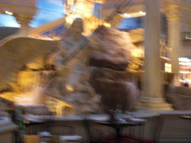 A blurry statue of some kind.  Might be Neptune?