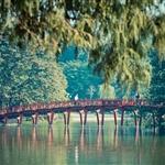 The Huc bridge over Hoan Kiem Lake .