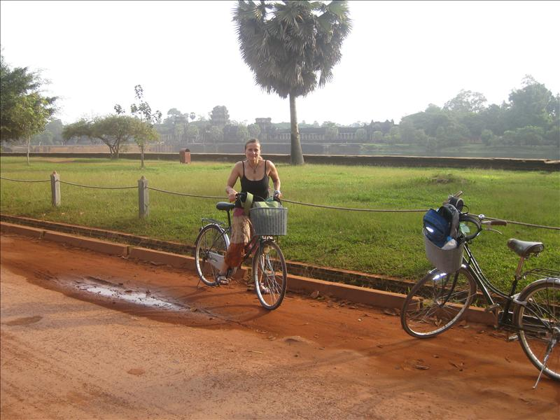 Renting bicycles to explore Angkor Wat , world famous temple complex  hidden away in the jungle for many centuries attest to the glories of the Khmer Empire