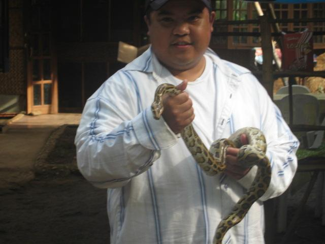 crazy person with a snake.
