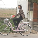 Girl on her pink bike