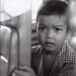 Kid on bus by film Illford 100