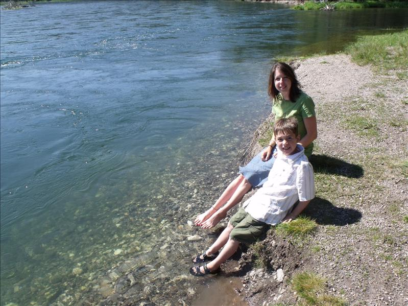 Dipping our feet in Yellowstone River. It was cold.