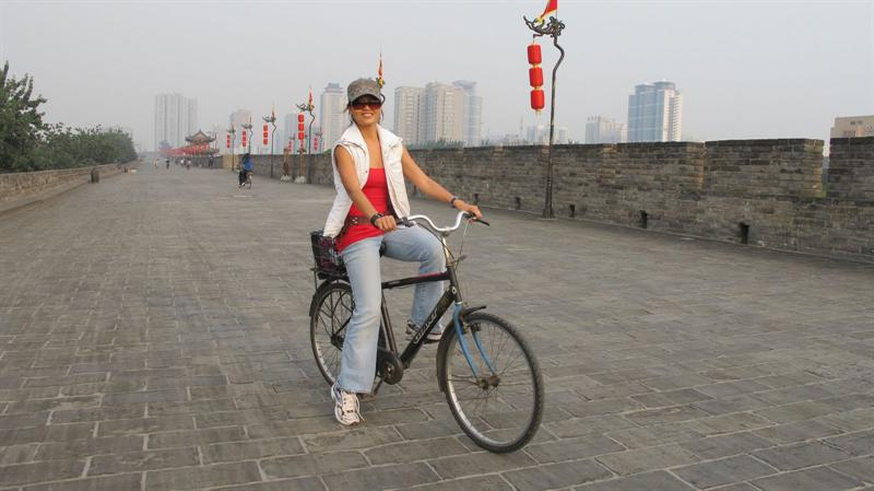 riding bike along the city wall