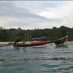 Taking a long boat to our Relax Beach resort, which is only accessible by boat or strengthenous hike