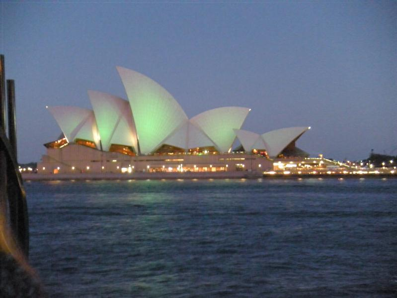 The opera house lit up at night