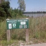 a sign for the walking trail