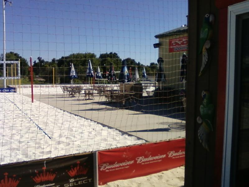 two outdoor vollyball nets and bar seating