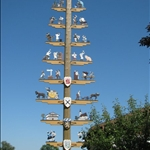 "Every town and village has its ""maypole"" showing local trades."