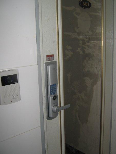 this is the door.  there are no housekeys only keypads where people punch in their secret code.