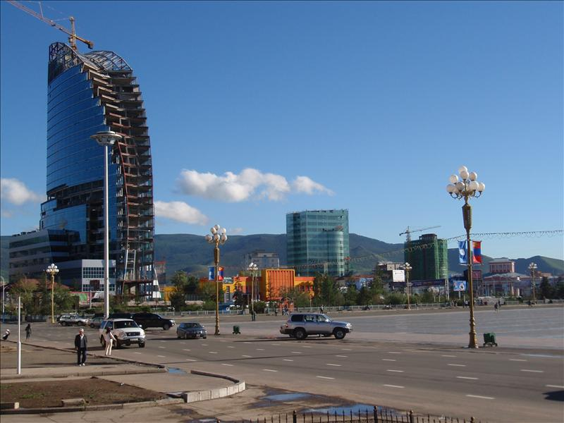 Half-built modern buildings from the outdoor bar on the edge of Sukhe Baatar Square