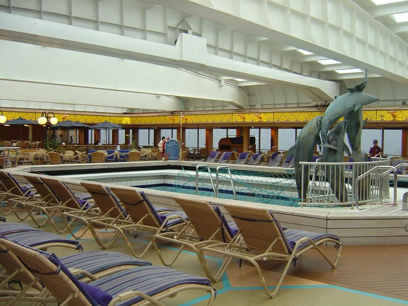 """Lido deck"" with swimming  pool in middle."