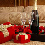 romantic-valentine-day-bedroom-decoration-with-gift-champagne-and-flower-romantic-bedroom-for-valentine-day.jpg