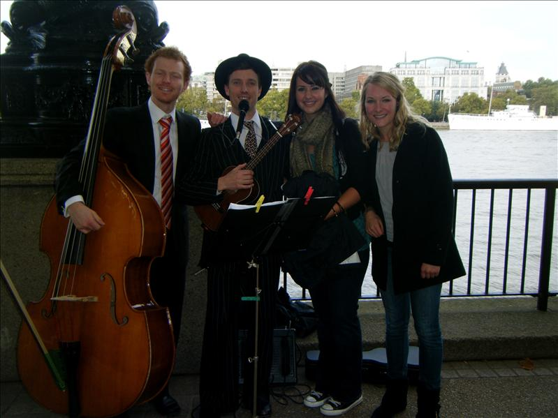 people playing music on the thames river