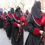 .... accompanied by penitents with bagpipes .