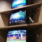 older televisions stacked in corners of room