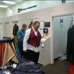 Larry picking up his tux at Twain Men
