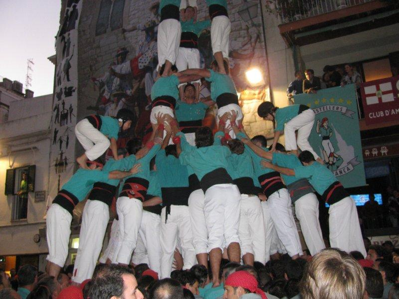 "Level 2 of a ""human tower"" with the little top level on the way up...."