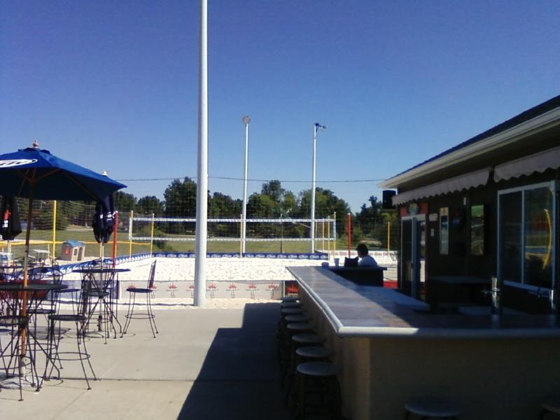 the patio bar and sand volleyball area