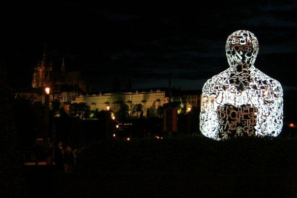 This is a sculpture of a seated man; entitled WE. Done by Spanish artist Jaume Plensa, the sculpture is made up of different characters from various world alphabets like Russian, Arabic, Hindi and Chinese.