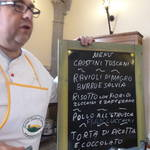 Chef Luciano reveals the menu and the plans for the day.