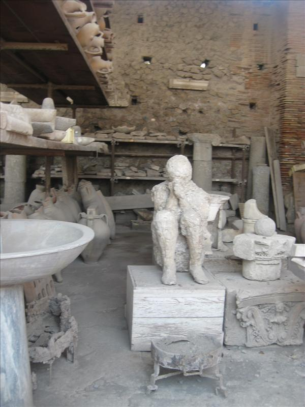 Cast of man covering mouth uncovered in Pompeii
