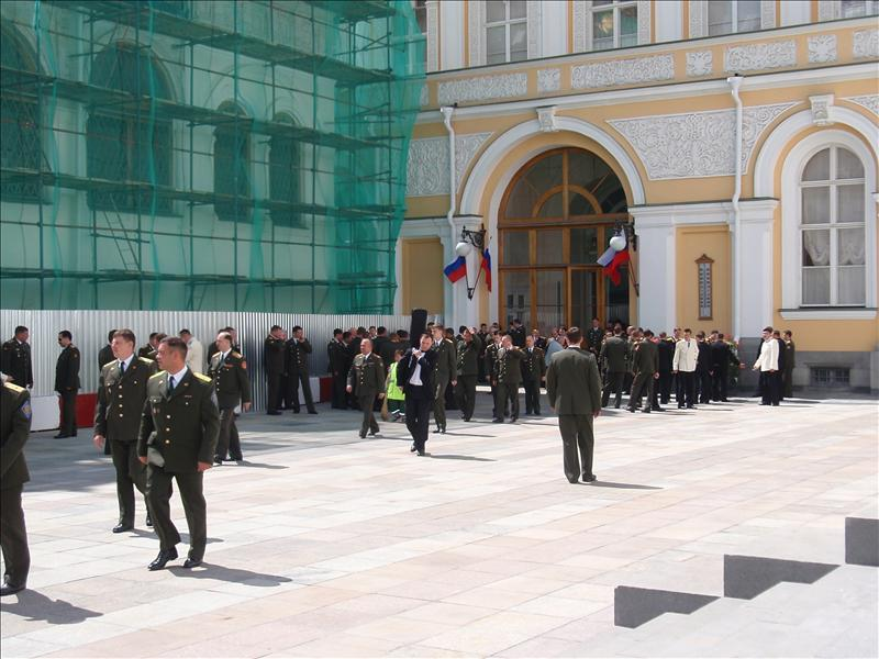 Official-looking people exiting the Grand Kremlin Palace