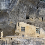 Les Eyzies - great prehistoric town. Cro-Magnon man surveys modern extension to his cave.