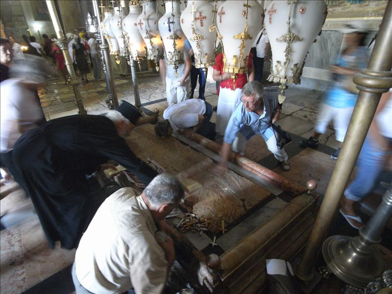 raised marble slab covering the rock on wich it is believed jesus's body was laid