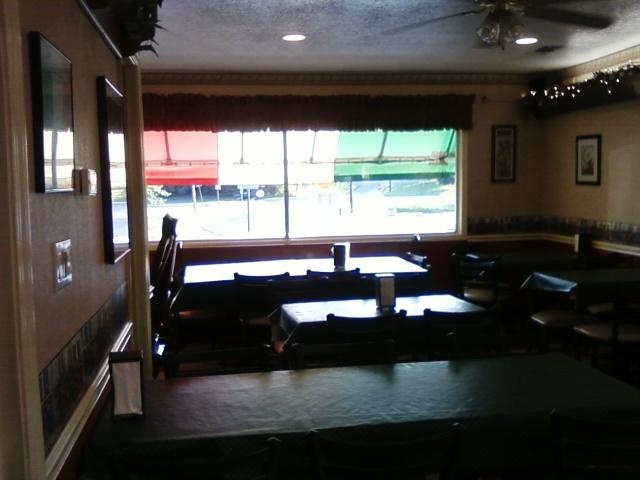 a view of the second dining area with Italian flag colored awning outside