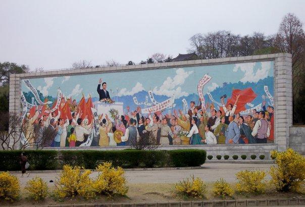 REVOLUTIONARY POSTER NEAR ARCH OF TRIUMPH, PYONGYANG