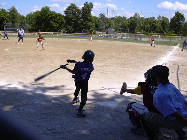 the batter swings and hits the ball