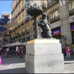 """The Madrona tree, the Spanish translation of which is """"Madrid"""".  Supposedly, the bear represents the citizens of this city, """"feeding on the resources of its beautiful city"""" (?)."""