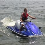 Riding the waves on a waverunner at Lake of the Ozarks, Missouri