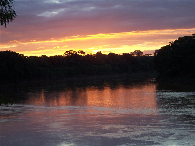 TAMBOPATA RESERVE, AMAZON, WITH A WONDERFUL SUNSET OVER THE RIVER