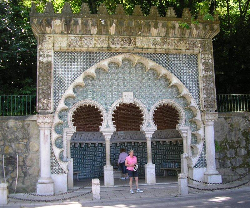 Replenishing the drink from the moorish fountain at Sintra.