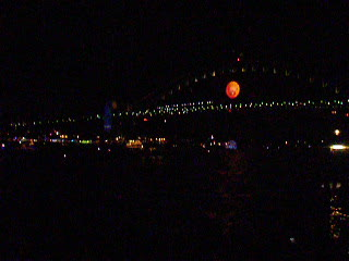 The boats going under Sydney Harbour Bridge after the fireworks