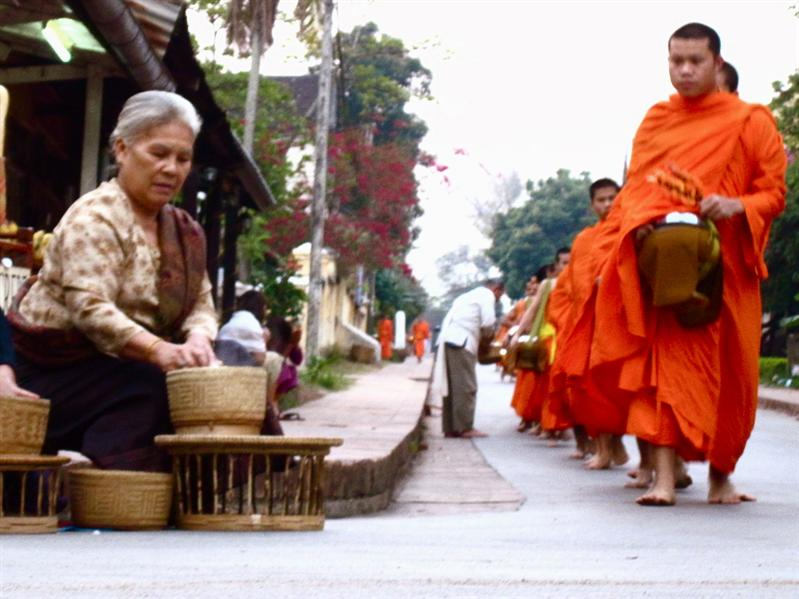 Giving alms again on my last day in Luang Prabang.