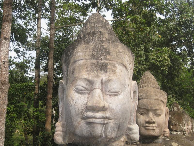 Bayon stone faces at the South entrance to Angkor Thom